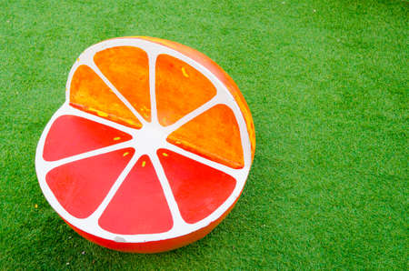 lawn chair: Orange chair on the lawn