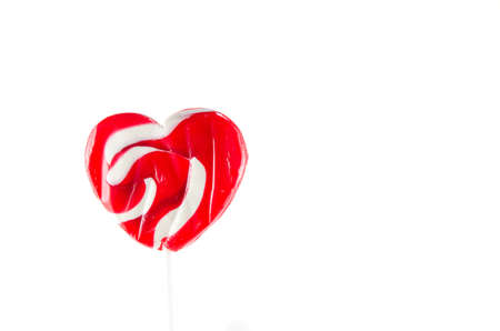 heart-shaped lollipop, isolated on white. Stock Photo