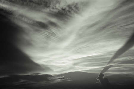 black and white clouds in the sunset Stock Photo