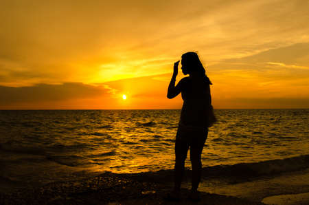 chuan: girl doing qigong at sunset on Cyprus