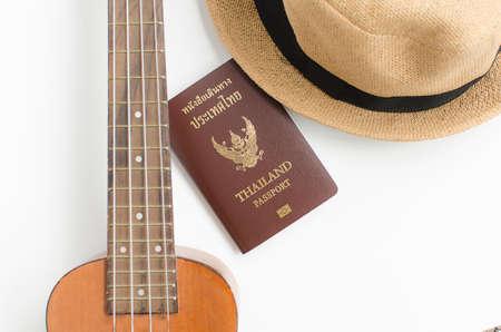 Thailand Passport ,Ukulele and brown hat on white background Stock Photo