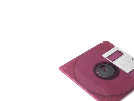 Floppy disk: Fuchsia pink floppy disk or diskette isolated on white background, floppy disk is magnetic computer data storage