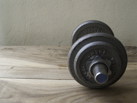 additional training: metal dumbbell on a old wooden background,for workout Stock Photo