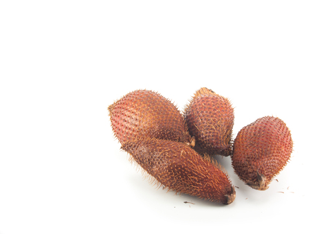 Salacca fruit on the white background,Salak fruit have many thorn on skin Stock Photo