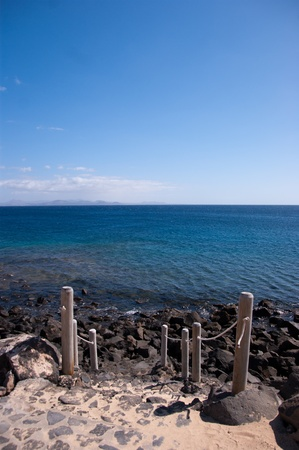 stone steps leading to the ocean in lanzarote