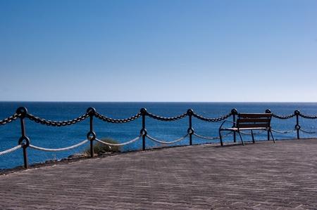 empty bench in playa blanca overlooking fuerteventura