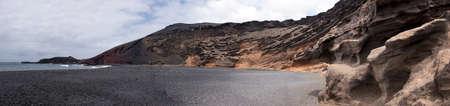 panoramic view of charco de los clicos, black beach in el golfo, lanzarote, canary islands