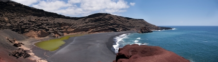 panoramic view of charco de los clicos, green lake and black beach in el golfo, lanzarote, canary islands Stock Photo