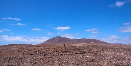 rock pile and stone circile in lanzarote with mountain background Stock Photo