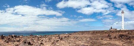 lanzarote: panorama of faro de pechiguera overlooking fuerteventura, playa blanca, lanzarote, canary islands