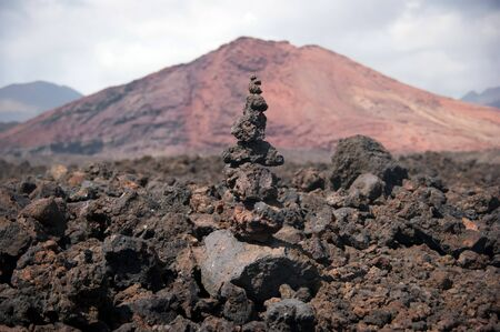 balanced stone pile with mountain background, lanzarote, canary islands Stock Photo