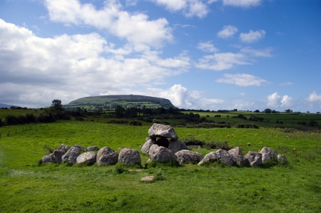 Dolmen in carrowmore with knocnarea mountain in the backgound