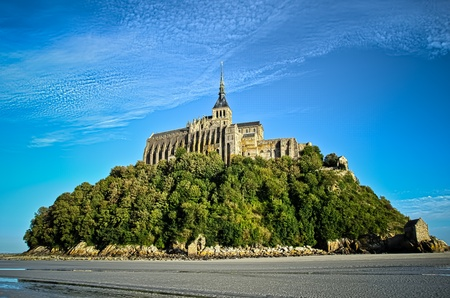 mont saint michel abbey on a low tide day photo