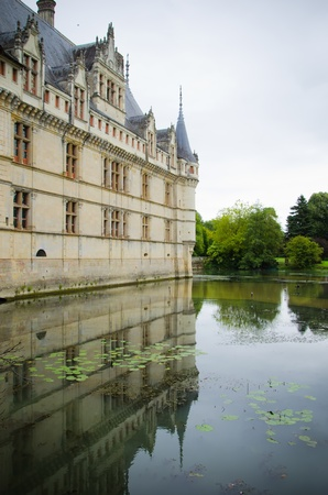 azay le rideau castle reflected in the gardens pond