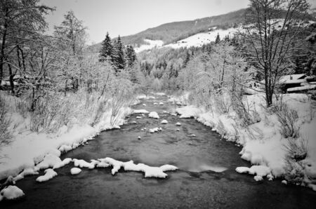 river during winter in val pusteria photo
