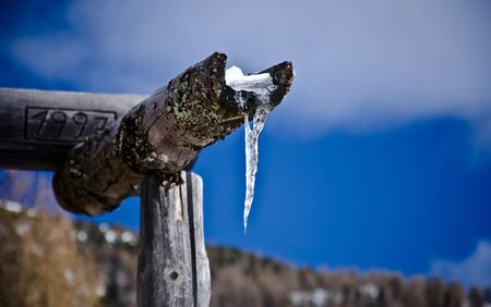 ice stalactite on a gutter pipe during a sunny winter day Stock Photo