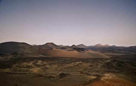 Timanfaya National Park, panorama and volcanic crater in the lava desert