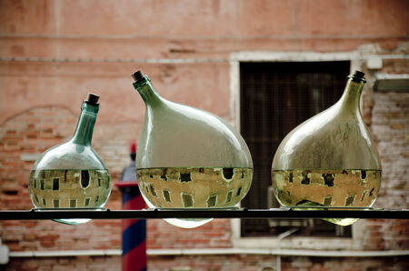artwork in Venice during Biennale 2013 consisting of three half empty bottles