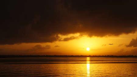hope: Airplane flying across sunrise in Cebu Philippines. Stock Photo
