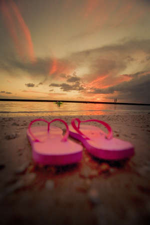 flip flops on beach photo