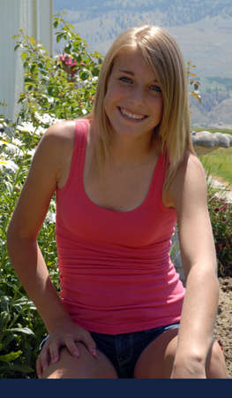 top: Young Girl Posing in Pink Tank Top