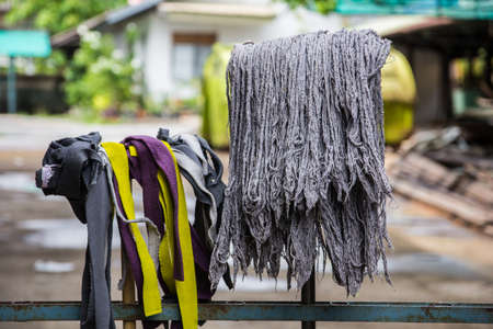 Old mops for cleaning floors. photo
