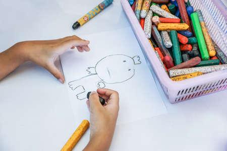 Boy drawing cartoon Stockfoto