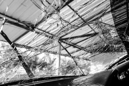windscreen: A shattered glass windscreen of a car
