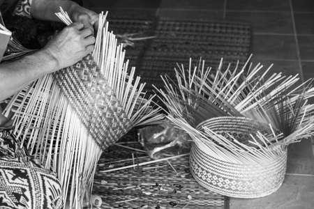 wicker work: craftsman hands working basketry in udon thani thailand