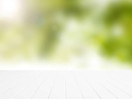 white wood floor: White wood floor with blurred green leaves background. Stock Photo