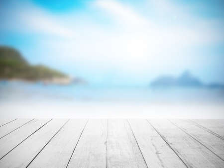 white wood floor: White wood floor with blurred sea background.