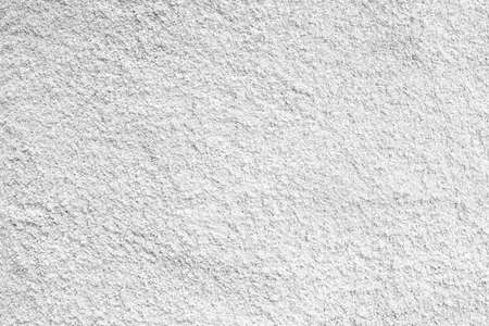 rupture: white cement; texture stone concrete,rock plastered stucco wall; painted flat fade pastel background grey solid floor grain.Rough top beige empty brushed print sand brick sepia grunge crack home dirty