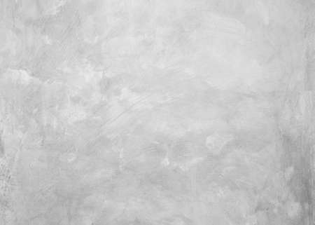 White cement texture plastered stucco wall painted fade background. Foto de archivo