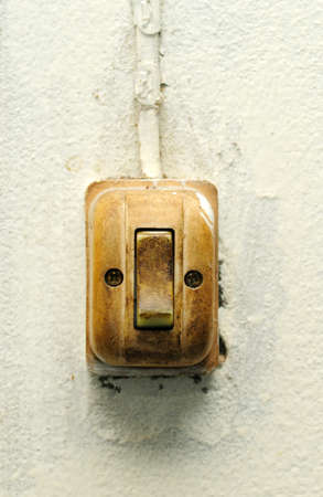 Old switch on white wall photo