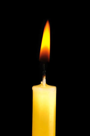 Yellow  candle in dark room