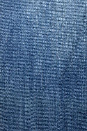 Textured striped blue jeans denim linen fabric background Stock Photo