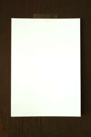White paper on wood wall