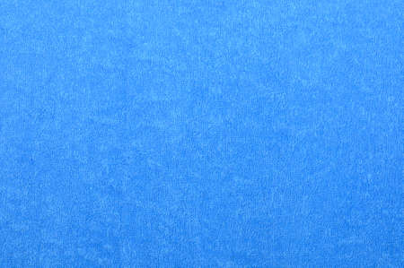 Blue natural plush terry cloth bath towel, macro background closeup  Stock Photo