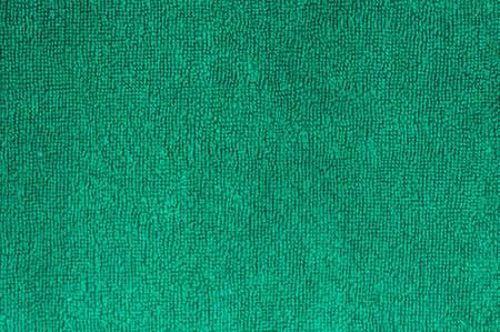 Green natural plush terry cloth bath towel, macro background closeup