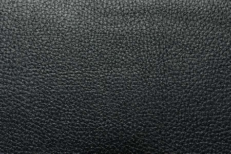 Black leather texture closeup. Useful as background for design-works. Stock Photo