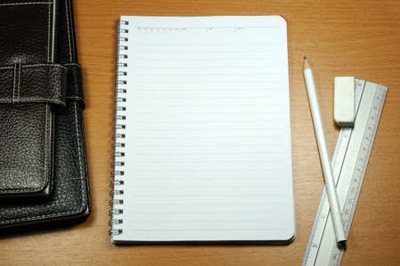 White Blank Notebook With White Pencil And Rubber On Wood Background Stock Photo