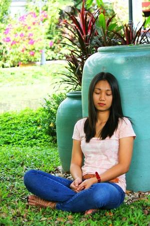 young girl sleep in the garden photo