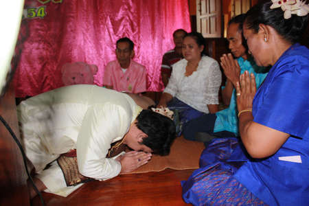 Thai traditional wedding - July 2011 - bride and groom are paying resect for their parent in the wedding ceremony
