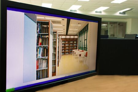NIDA electronic library-July 2012-bookshelf with the book in the library on the screen of Desktop computer