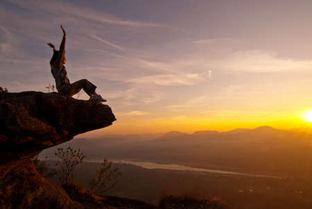 Happiness on the cliff at sun rise