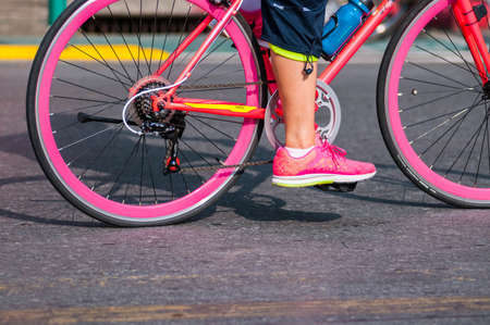 pink bike: Pink bike and shoes Stock Photo