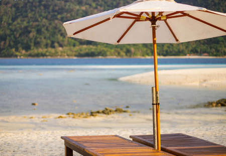 umbella: Relaxing zone on the beach Stock Photo