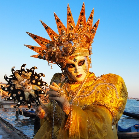VENICE - FEBRUARY 21  An unidentified person in a carnival costume attends the end Carnival of Venice,  February 21, 2012 in Venice, Italy