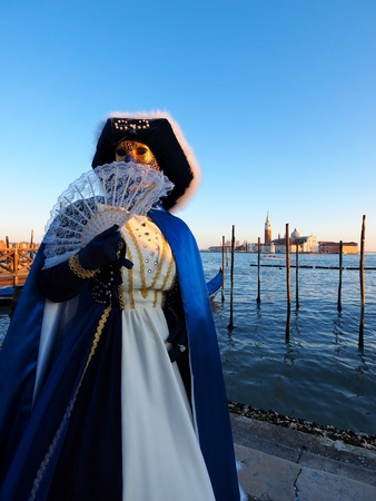 mardigras: VENICE - FEBRUARY 21  An unidentified person in a carnival costume attends the end Carnival of Venice,  February 21, 2012 in Venice, Italy  Editorial