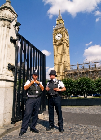 TWO POLICEMANS, LONDON - August 11  Police patrol in front of the Big Ben August 11, 2009 in London, England